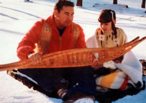 Dale and Mariah Cooper demonstrate snow-shoeing for the Ojibwa community